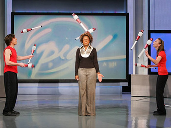 Oprah gets in on Olga and Vova Galchenko's juggling act.