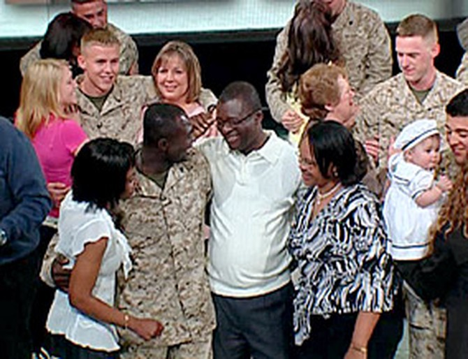 The Marines of Alpha Company reunite with their families.