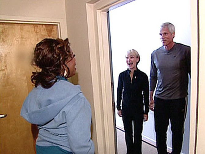 Adrianne and Scott give Oprah a tour of their home.