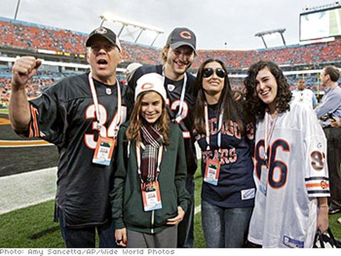 Demi Moore at Super Bowl XLI with her ex-husband Bruce Willis, husband Ashton Kutcher and daughters Tallulah and Rumer.