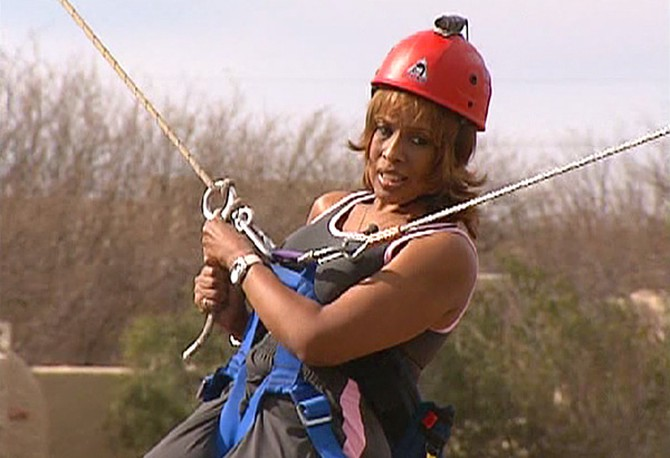 Gayle holds the rope for dear life.