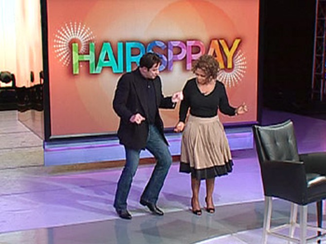 John shows Oprah the dance moves he used in 'Hairspray.'