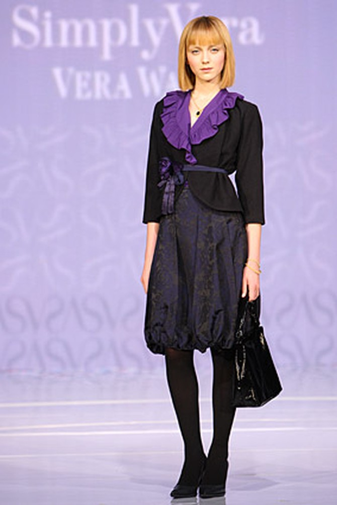 Vera Wang's belted jacket, purple blouse and brocade skirt