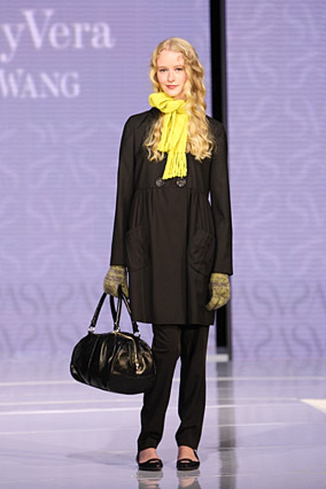 Simply Vera's black pea coat and yellow scarf