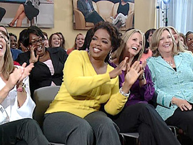 Oprah with the men's wives