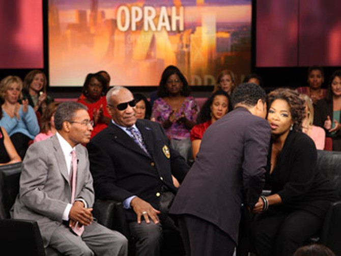 A show guest says hello to Oprah during taping.