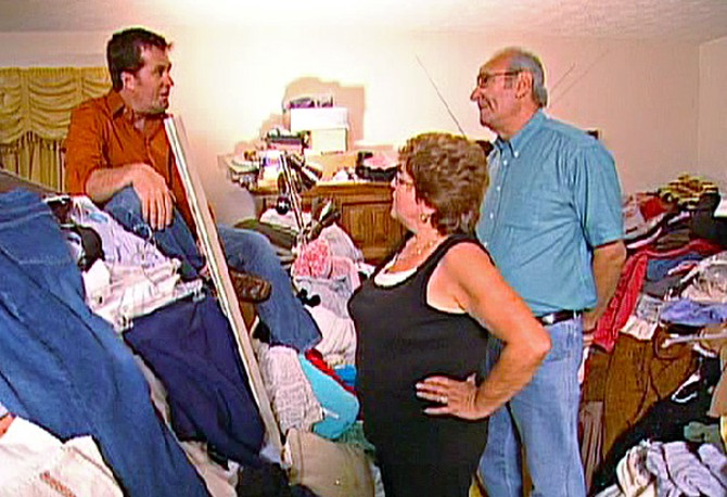 Peter, Sharyn and Marvin tackle the piles in the master bedroom.