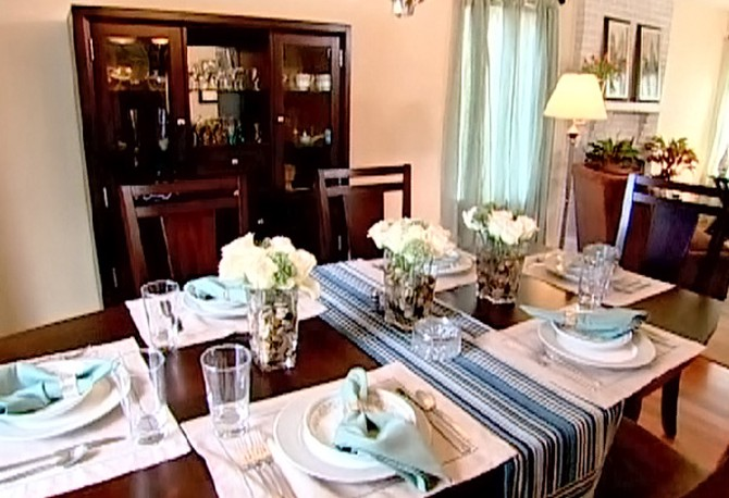 The dining room table features Sharyn's own dishes.