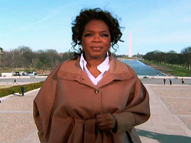 Oprah on the steps of the Lincoln Memorial