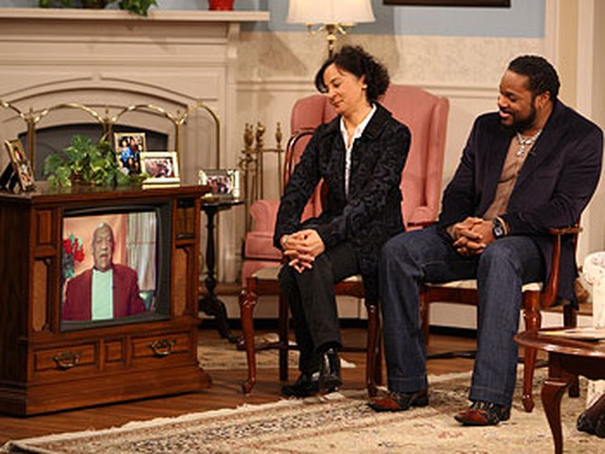 Sabrina Le Beauf and Malcolm-Jamal Warner watch an interview with their TV dad.