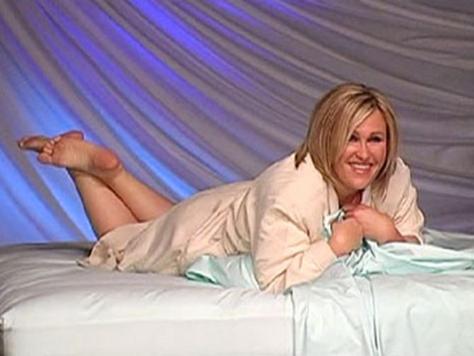 Anita poses on a bed during her photo shoot.