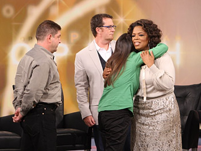 Oprah greets Sharyn and Marvin's grown children.