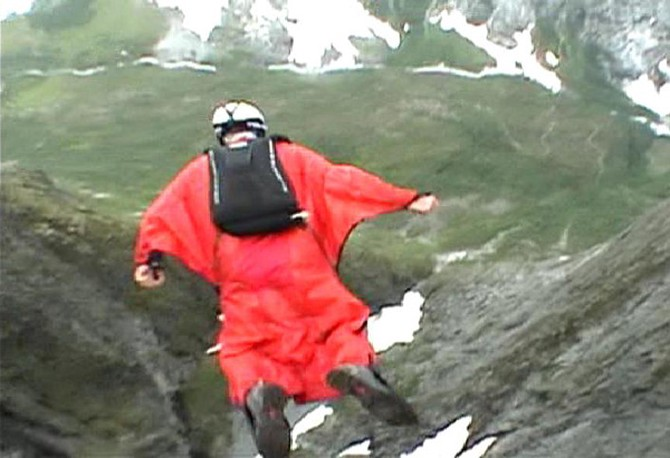 One of the Birdmen jumps off a cliff.