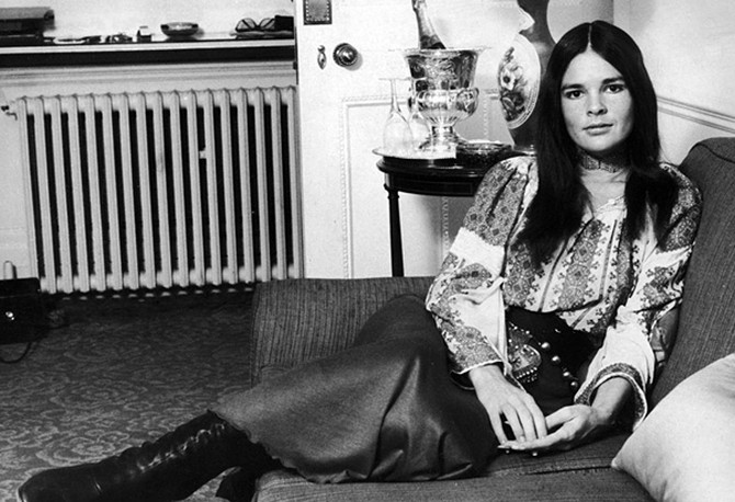 Ali MacGraw wearing a bohemian blouse and long skirt