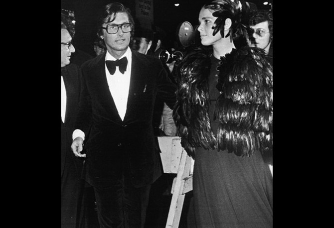 Ali MacGraw wearing a feathered cape at The Godfather premiere