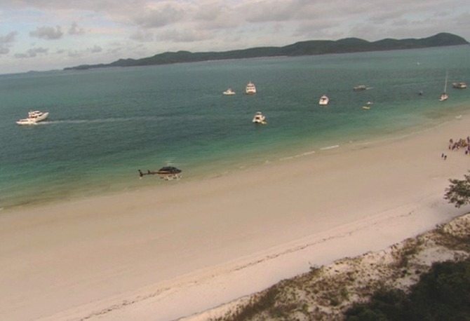 Oprah arrives at a beach barbecue at Whitehaven Beach