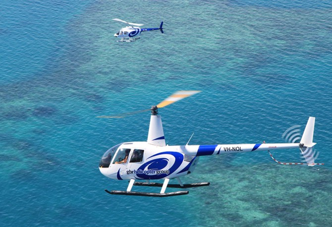Helicopters fly over the Great Barrier Reef