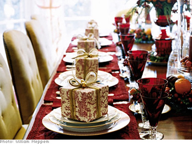 table set with goblets, candles, and presents